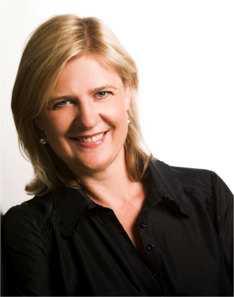 Robynne Berg. A White woman with blonde hair that falls straight down to the top of a Black button up collared Shirt. She is smiling to Camera, wearing pearl earrings.